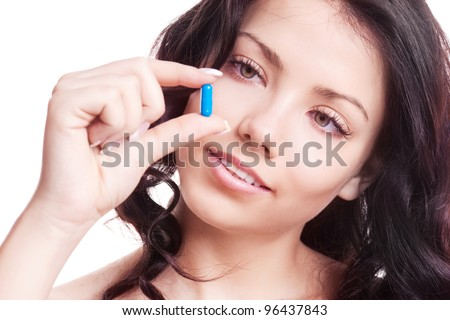 pretty young woman taking pills, isolated against white background - stock photo