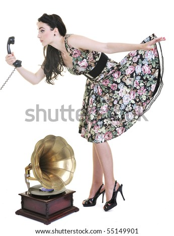 pretty young woman talking by old phone and mouse cursor arrow is holding her skirt