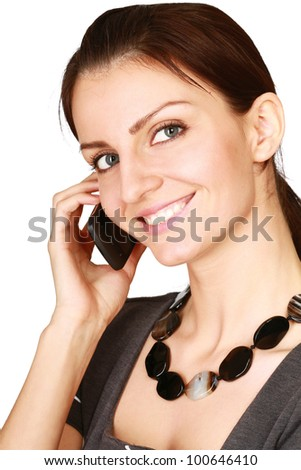 Pretty young woman talking on cell phone isolated on white background - stock photo