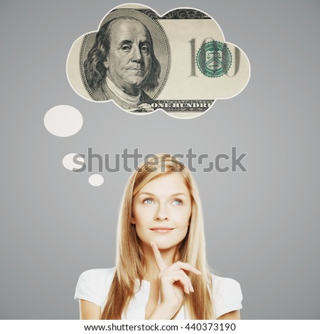 Pretty young woman thinking about money on light grey background - stock photo
