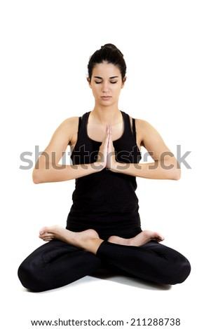 Pretty young woman training yoga - stock photo