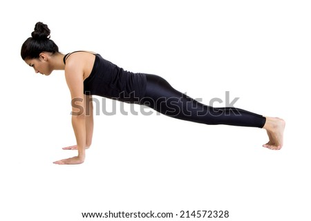 Pretty young woman training yoga