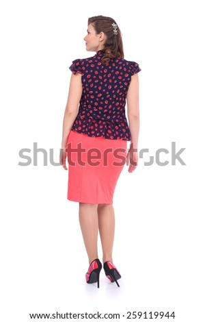 pretty young woman wearing a beautiful costume, back view - stock photo