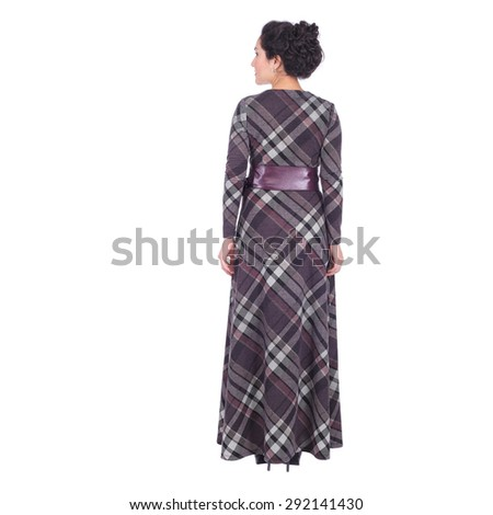 pretty young woman wearing a long dress, back view - stock photo