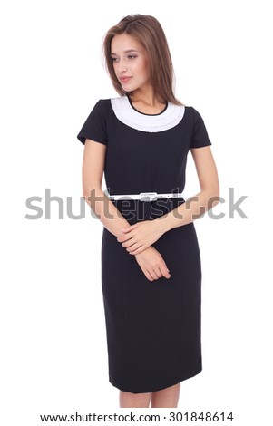 pretty young woman wearing black and white office dress - stock photo