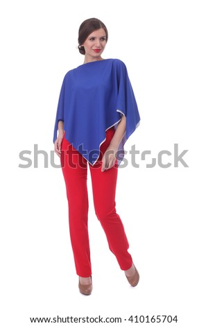 pretty young woman wearing blue and white tunic and red pants - stock photo
