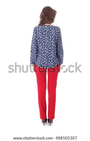 pretty young woman wearing blue blouse and red pants