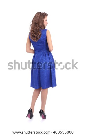 pretty young woman wearing blue dress - stock photo
