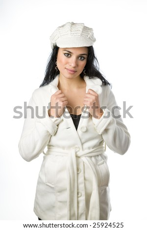 Pretty young woman wearing cold weather coat and hat