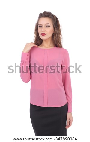 pretty young woman wearing pink blouse and dark office skirt