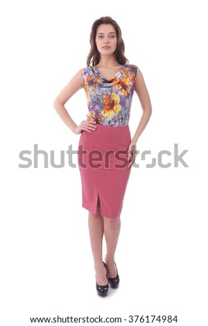 pretty young woman wearing pink skirt and flower print top - stock photo