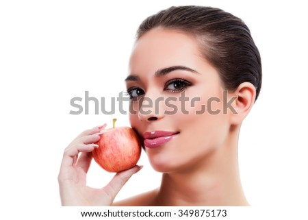 Pretty young woman with a red apple, isolated on white
