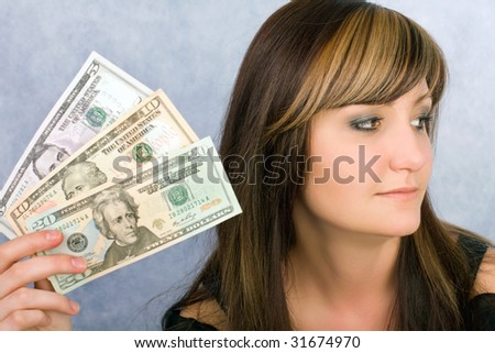 Pretty young woman with American dollars