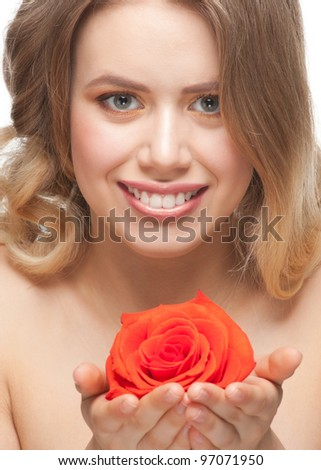 Pretty young woman with beautiful fresh make-up and perfect healthy skin with rose in her hands - stock photo