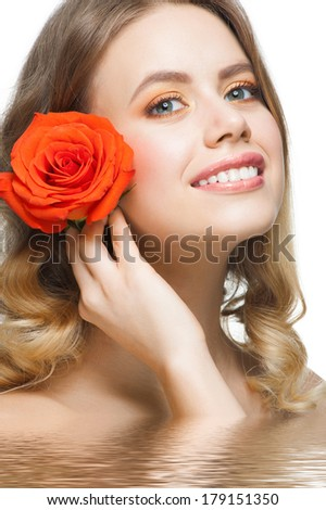 Pretty young woman with beautiful fresh makeup and perfect healthy skin with rose in water - stock photo