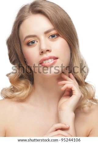 Pretty young woman with beautiful make-up and perfect healthy skin touching her neck - stock photo
