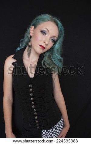 Pretty young woman with blue hair against a black background
