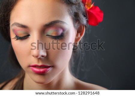 pretty young woman with bright make-up