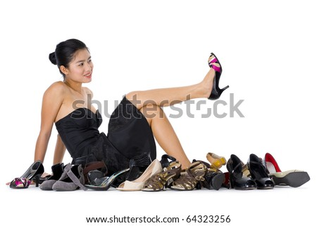 pretty young woman with buying shoes addiction, isolated on white background - stock photo