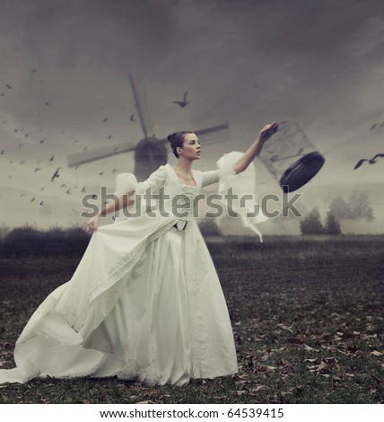 Pretty young woman with cage - stock photo