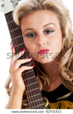 Pretty young woman with electric guitar isolated - stock photo