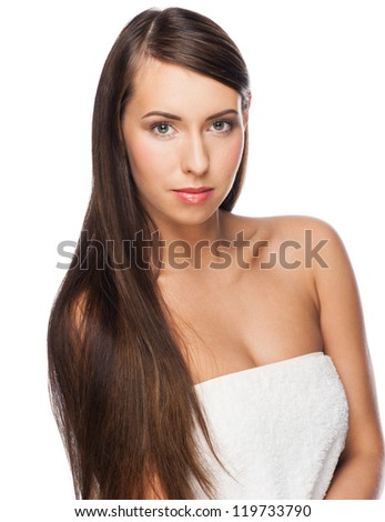 Pretty young woman with long straight brown hair looking at camera, isolated on white background