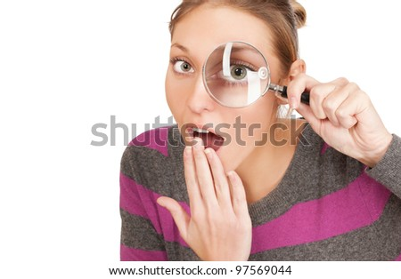 pretty young woman with magnifier isolated on the white background