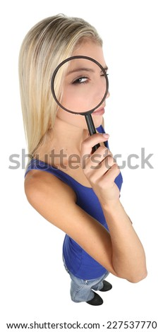 Pretty young woman with magnifying glass isolated on white - stock photo