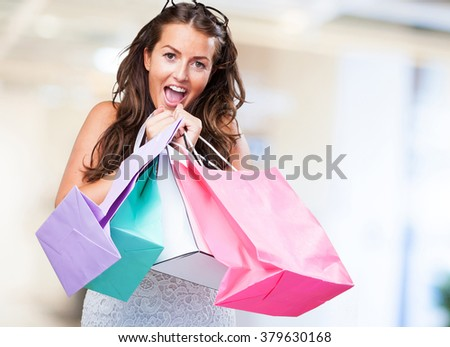 pretty young woman with shopping bags - stock photo