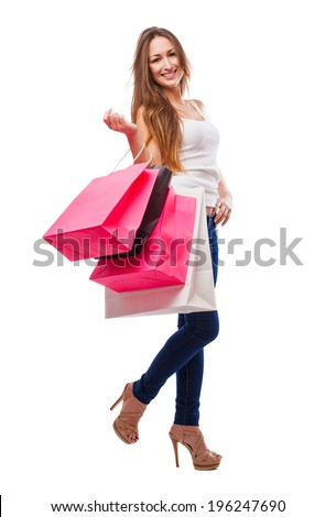pretty young woman with shopping bags in a white background - stock photo