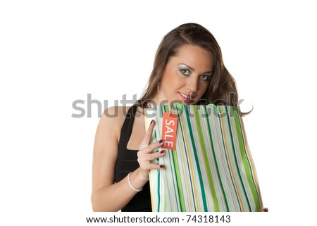 Pretty young woman with shopping bags on a white background - stock photo