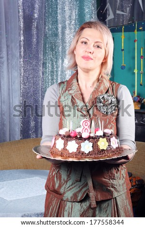 pretty young woman with the birthday cake - stock photo