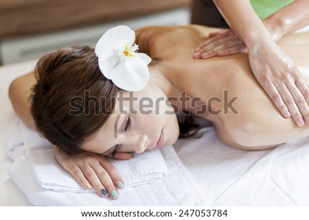 Pretty young women having a massage - stock photo