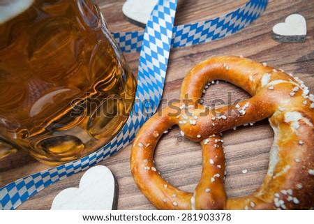 pretzel and beer still life for oktoberfest - stock photo