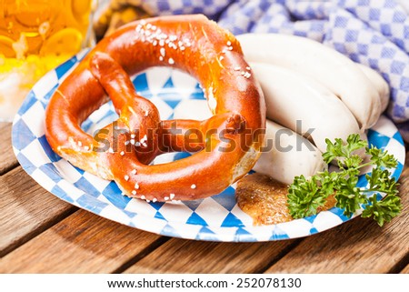 pretzel, white sausage and beer - stock photo
