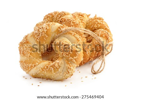 Pretzel with sesame seeds and salt - stock photo