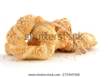 Pretzel with sesame seeds isolated in white background - stock photo