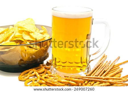 pretzels, breadsticks, chips and beer on white background - stock photo