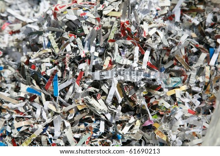 preventing ID Fraud with Shredded paper, shredded checks, credit cards and other sensitive information - stock photo