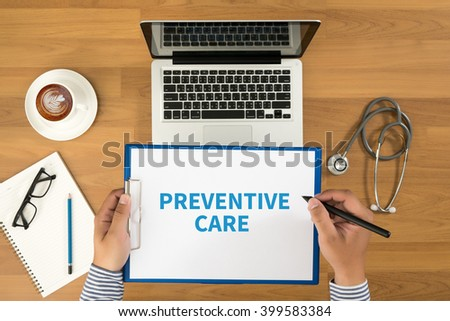PREVENTIVE CARE  Doctor writing medical records on a clipboard, medical equipment and desktop on background, top view, coffee - stock photo