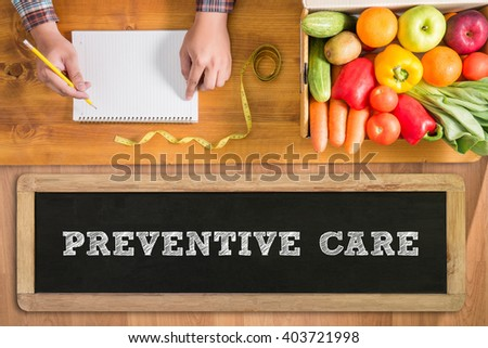 PREVENTIVE CARE  fresh vegetables and  on a wooden table - stock photo