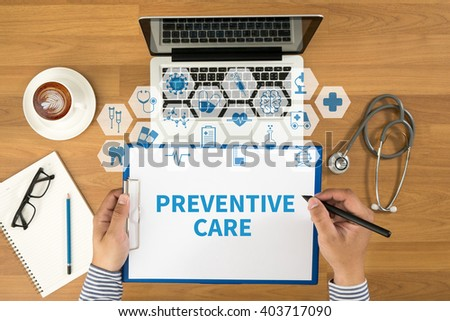 PREVENTIVE CARE  Top view, Doctor writing medical records on a clipboard, medical equipment - stock photo