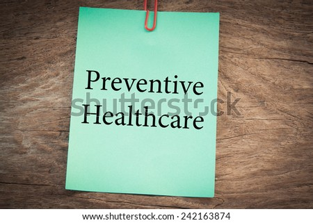 preventive healthcare text concept on green note  - stock photo