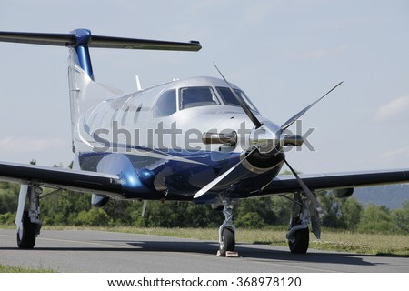 PRIBRAM AIRPORT, CZ - 12 JULY 2011: Single turboprop PILATUS PC-12 NG  aircraft parked on runway, Pribram airport.