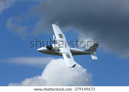 Pribram Airport, Czech Republic - 28 May 2010. The small twin-engine plane Tecnam P2006T flying over airport.
