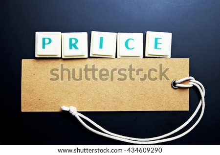 Price concept. The words spelled by letters with price tag, brown label on blackboard with wooden border. Dark tone. - stock photo