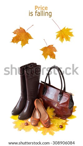 Price is falling (Leather boots and bag with autumn leaves isolated on white) - stock photo