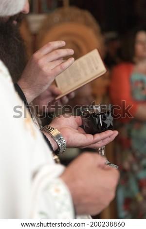 Priest during a orthodox wedding ceremony - stock photo