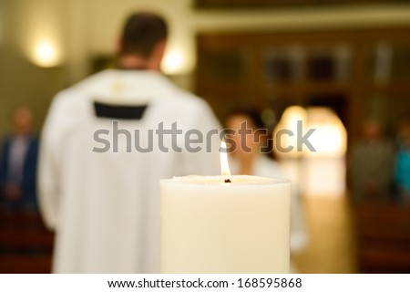Priest during a wedding ceremony - stock photo