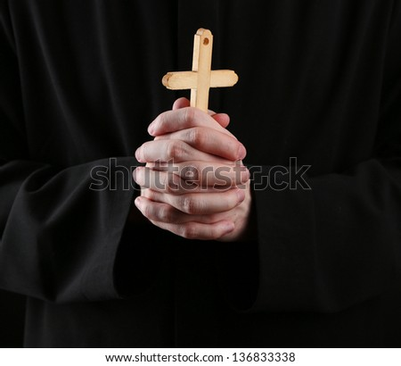 Priest holding cross, close up - stock photo